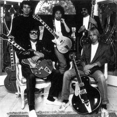 The Traveling Wilburys, this picture is backwards.  They are right handed players.