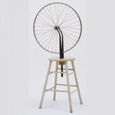 MARCEL DUCHAMP 1951: Bicycle Wheel. Assemblage: metal wheel mounted on painted wooden stool. original from 1913 was lost