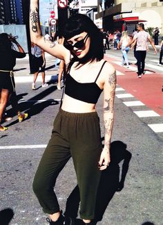 Cat eye sunglasses with black crop top, green trousers & Dr Martens shoes by notbrub