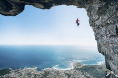 "Photographer Micky Wiswedel won the Wings category with this image of climber Jamie Smith in Cape Town, South Africa. Wiswedel: ""My buddy Jimbo had been opening new hard routes in the area and we wanted to try and capture some of the climbs. With climbing photography it's not often you can just walk somewhere to get a good angle; most good shots require some form of rigging. The angle of this image happened by chance. We were setting up for another shot but when I looked back I knew we had…"