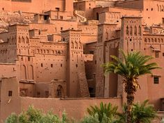 The walls of UNESCO World Heritage Site Aït Benhaddou in Quarzazate Provice, Morocco, Few places inspire wanderlust like the colorful country of Morocco, where bright blue cities, Sahara dunes, maze-like medinas, mounds of spices, and much, much more exist in a space slightly larger than California.