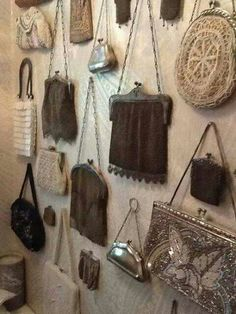 I need to do this with my antique purses!  Or maybe in a large picture frame would look good too.