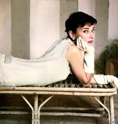 audrey hepburn in a simple white dress and timelessly gorgeous red lip