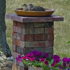 By stacking old bricks into a pillar, you can build a sturdy birdbath base that needs only a bowl or tray on top to function as the water basin