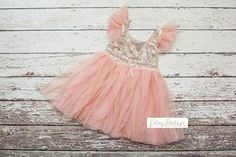 This adorable dress is covered in sparkle!!! The top is covered in gold sequins and the bottom is a pink tulle with gold sparkle dots. Your little Cutey Patutey is sure to feel like a princess in this dress!   Sizes available: 2T/3T                           3T/4T                           4T/5T                           5/6                           6/7  ***As with all of our products...wash on delicate and hang to dry***