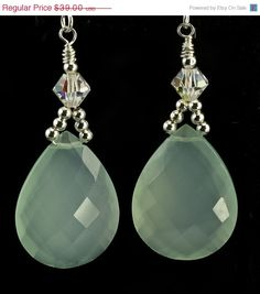 aqua chalcedony. These lovely earrings combine sterling beads and faceted chalcedony brios with accents of Swarovski crystal.