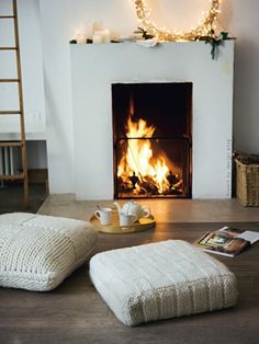Cozy winter fire and sweater pillows