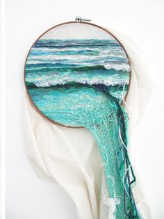 Embroidered landscape art by Anabarboza