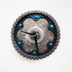Twilight Zone Clock - Made with parts sourced from local vendors in and around Washington state, these fully functional timepieces from reCycle Clocks combine variously shaped and colored sprockets to create eye-catching, ready-to-hang timepieces.