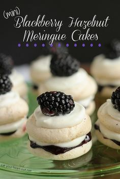 These fun hazelnut meringue cookies are layered with blackberry preserves, whipped cream, and a fresh blackberry to make the cutest two-bite meringue cakes you ever did see.