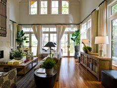 Travelers palm trees, set in ceramic planters, flank the back deck entrance and draw eyes up to the dramatic ceiling.