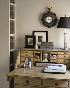 An antique Swedish desk occupies a front corner of the bedroom; its many drawers keep mail out of sight. The desktop displays some favorite possessions.  -- Martha Stewart Living, September 2005