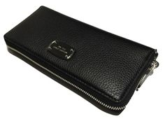 """Michael Kors ZA Travel Continental Jet Set Clutch Wallet Black/Silver   Wrapped in beautiful soft pebbled leather with polished gold or silver tone hardware Interior zippered coin pocket, 16 credit card slots, and few bill compartments bill compartments, ID Window Measures approximately 8"""" (L) x 4"""" (H) x 1"""" (W)"""