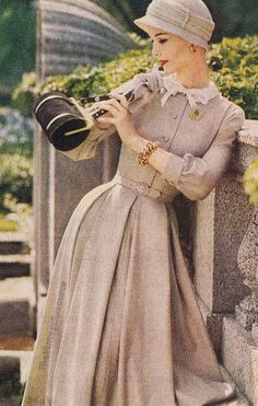 monochromatic glam 1956 tan everything dress hat wool brown light coors fall winter mid 50s era pleated full skirt wasp waist color photo print ad model back round roll purse handbag