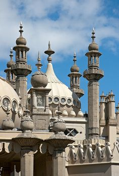 Spires, Royal Pavilion, Brighton: The Pavilion is a former royal residence. It is often referred to as the Brighton Pavilion and was built by the British in the Indo-Saracenic style prevalent in India for most of the 19th century