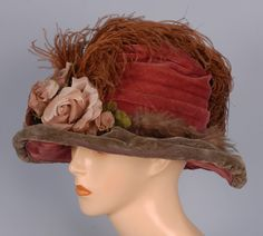 1910-1920 lady's two-tone velvet hat: ruched dusty rose crown and green brim decorated with three cloth roses and ostrich plume, and under-brim in rose velvet with self flower.