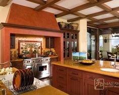 Get a real Mexican feel in this kitchen with a stove alcove and the bright wrm colors