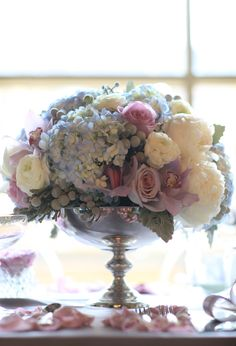 Pastel arrangement of hydrangea, roses, orchids and peonies