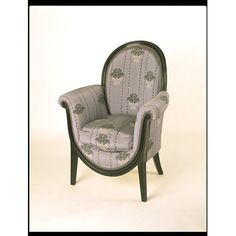 This chair is part of a large suite of bedroom furniture made for a Paris apartment. It is designed in a modified Louis XVI style, seen through the eyes of 19th century revivals. In this it shows clearly the historicising character of much 'progressive' French design of the early decades of the 1900s. The brocaded silk was also used for curtains, hangings and covers in the bedroom (see Museum no. W.46-1981).