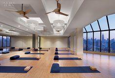 An Exercise in Restraint: James Harb Re-Envisions Equinox | Pendant fixtures in the yoga studio are by Studio Elle. #design #interiordesign #interiordesignmagazine #gym #wellness