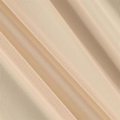 Telio Stretch Nylon Mesh Knit Nude from @fabricdotcom  With a soft hand and feel, this nylon shaper mesh fabric has four way stretch. With 50% vertical stretch and 25% stretch across the grain, this shape wear fabric can be used to line garments in order to  give the body a sleek and smooth silhouette. Perfect for use under sheer fabrics, linings, lingerie and more!