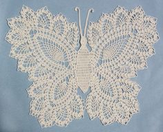 THIS IS A DOWNLOAD CROCHET PATTERN ONLY - NOT THE ACTUAL ITEM    PA140 - Butterfly Doily 2 Crochet Pattern    This beautifully crochet doily is an amazing addition to your living space. This large doily, 18 inches tall and 20 inches wide, is ideal for table decorations, a setting place for vases, or as a simple embellishment to a room. This butterfly doily is easy to crochet so get started today!    Original Crochet Design by: Maggie Weldon    Skill Level: Easy    Size: 18″ tall x 20″ wide…