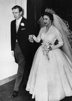 South Carolina native Eartha Kitt wore a custom chiffon dress trimmed in satin for her at-home wedding to real estate developer Bill McDonald. She finished her wedding day ensemble with a 5-strand pearl necklace, along with coordinating satin hat, shoes, and handbag. #southernfashion #vintageweddingdresses #iconicweddingdresses #vintagesouthernstyle #southernliving