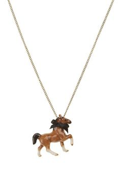 """Tiny prancing horse porcelain necklace with black ribbon bow.  Hand painted beautiful porcelain horse on an 18"""" or 24"""" gold, silver or antique brass plated brass based necklace.  Also available on a 18"""" or 24"""" sterling silver chain."""