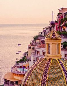 Positano, Italy at dusk. Imagine kissing the love of your life with this view as a background...