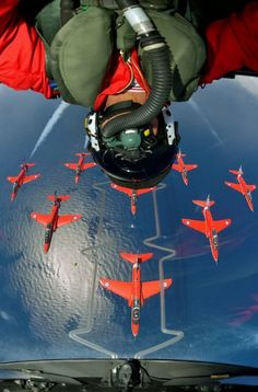 The Red Arrows are seen flying in formation in a photograph taken with the help of aviation specialist Katsuhiko Tokunaga while the famous display team flew over RAF Akrotiri in Greece