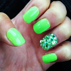Neon green nails with green diamonds