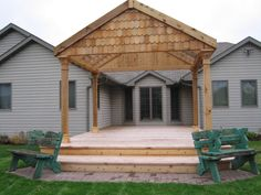 A wooden deck with a  twist on the traditional pergola. The Vande Hey Company, Inc.
