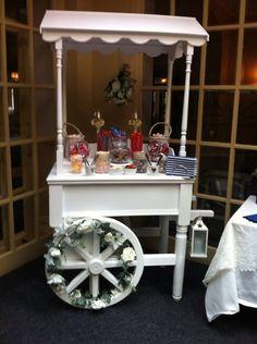 Oops-a-daisy Wedding Cart/Candy Cart. https://www.facebook.com/OopsADAisyPartyEntertainers