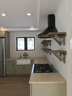 #rustic wooden #kitchen #shelving with dark details for a #modernfarmhouse feel. #catskillfarms