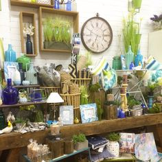 Blues, lime, green and navy shop display, visual merchandising our home decor shop in Lilydale Melbourne. Cushions, clocks, vases, photo frames, lamps, candle holders and more homewares.