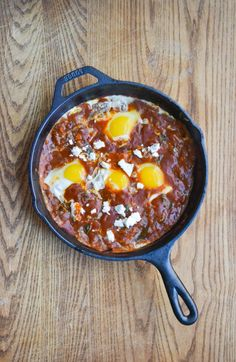 shakshuka - eggs baked in spiced tomato sauce topped with feta cheese