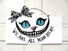6x12 in. recycled wood sign acrylic paint with print. Coated with indoor/outdoor gloss and clear glitter. Wire and bow accent. Cheshire cat. We,re all mad here. -------( Production & Shipping)--------