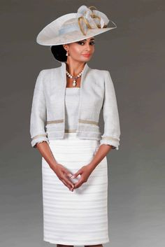 This knee length fitted outfit features a satin style skirt. The jacket is in a contrasting fabric that compliments the skirt. Colour: Silver/ivory