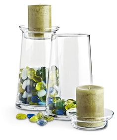 Fill two-piece clear candle holders (like this set from Pier 1) with natural or found objects that correspond to the theme for centerpieces, etc.