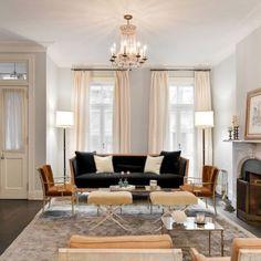 Nate Berkus dark sofa, light walls, camel colored chairs