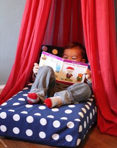 Crib Mattress turned Reading Nook!  Check out the blog for other alternative uses for the crib mattress your child has outgrown.  www.petiteliterary.com