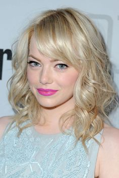 obsessed with emma stone & these curls and bangs.