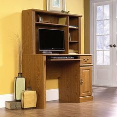 """Orchard Hills 57"""" Computer Desk with Hutch by Sauder. $181.99. 401353 Features: -Computer desk with hutch.-Slide out keyboard and mouse shelf with metal runners and safety stops.-Storage area behind raised panel door holds vertical CPU tower.-Hutch features three adjustable shelves for versatile storage options.-Made in USA. Color/Finish: -Carolina oak finish.-Brass finished hardware. Assembly Instructions: -Drawer features patented T-lock assembly system.-Assembly ..."""