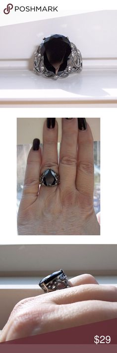 STAINLESS STEEL Simulated Black Onyx Filigree Ring This beautiful fashion ring has a Pear shape simulated Black Onyx Cubic Zirconia stone in the center, filigree design on each side with clear bezel set CZs. All stones are AAA Grade Cubic Zirconia. Solid TK316 Stainless Steel (no plating) is high polished to a mirror finish. Stainless Steel Jewelry is hypo-allergenic, non tarnish and never turns your finger green. It is a darker metal than sterling silver.  If you don't see the size you want…