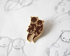 Otters Holding Hands Enamel Pin