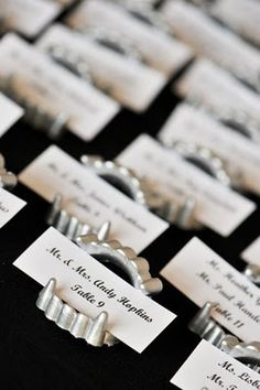 Add photos in place of name cards? Spray paint cheap vampire teeth with silver for really cool vampire fangs place card holders!