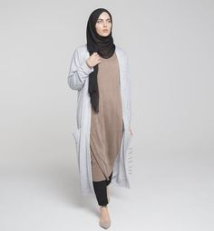 - Modest everyday essentials, balancing simplicity and comfort with style.  Mushroom High Neck Jumper  Black Crossover Trousers Chalk Maxi Cardigan  www.inayah.co