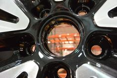 Peeking into the #Warehouse from the center of a new #wheel. New products to be released this week. #rims #StayTuned #MadeInAmerica #wheelporn #newrims #manufacturing #bornintheusa
