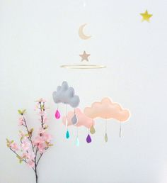 """Wonderful cloud mobile with 3 gorgeous puffy fluffy felt clouds on a 6"""" gold ring, one wood moon and one wood star. A very unique rainstorm! It hangs from a fine fishing line cord...so lovely! Via en.DaWanda.com."""
