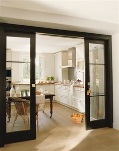 Love the black doors and white kitchen. YOURS TRULY: design